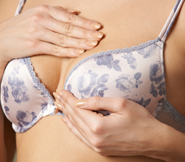 Woman Wearing Bra Examining Breast