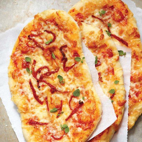 Three-cheese pizza with sun dried tomatoes