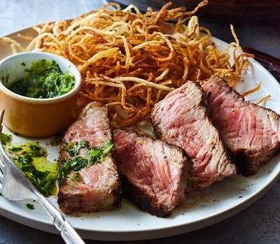 Barbecued steaks with Argentinean sauce