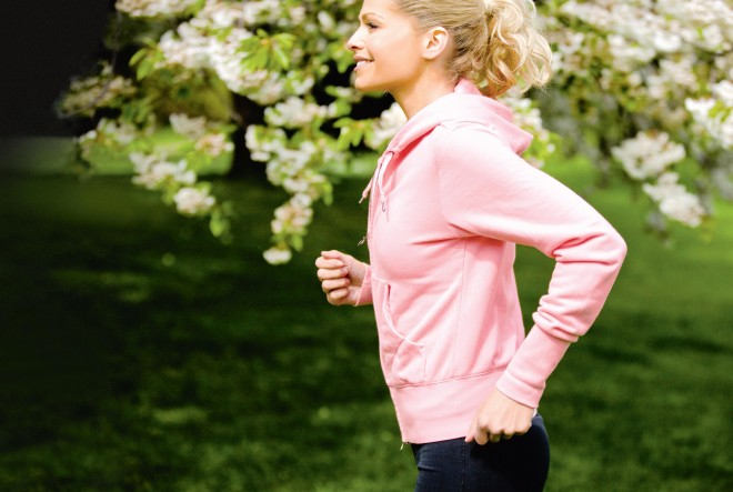 Woman walking or running in the spring