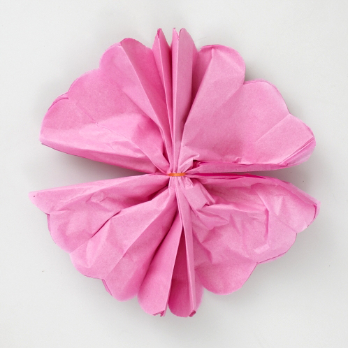How to make a beautiful floral tissue paper bow pull the individual layers of tissue paper toward the middle be very careful not to tear the paper cheap tissue paper from the dollar store rips easily mightylinksfo