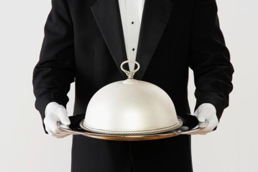 Waiter, butler, with silver platter tray