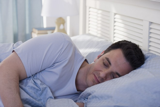 man sleeping on pillow, bed