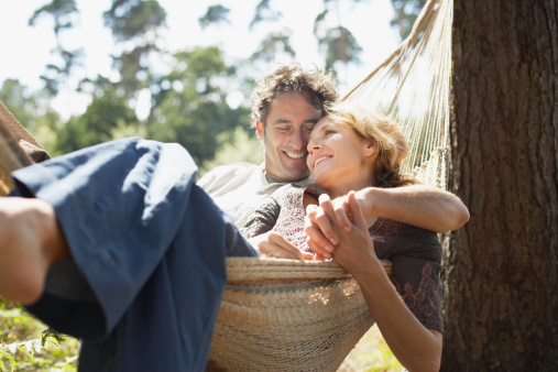 couple smiling in hammock, love