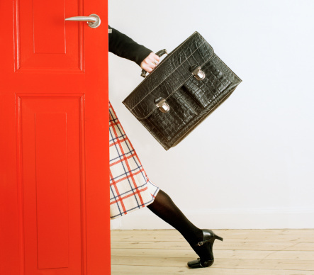 woman, red door, breifcase, running late