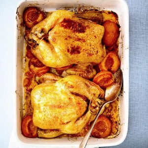 Glazed Cornish hens with roasted apricots.