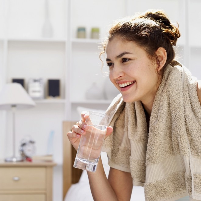 woman exercising drinking water, towel
