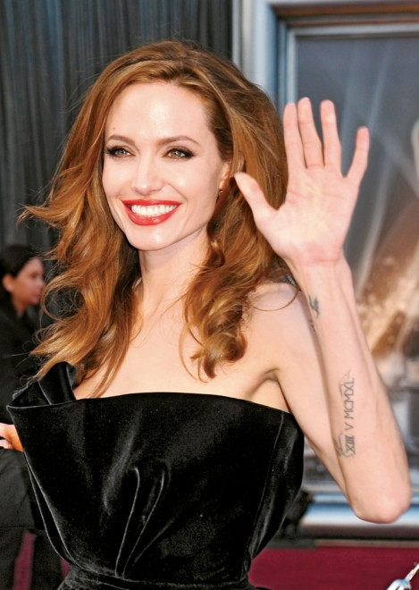 Angelina Jolie tattoo on wrist and arm