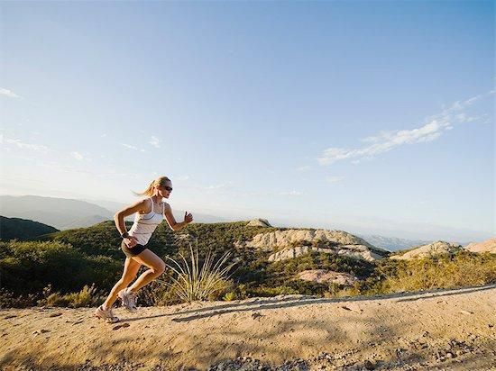 running woman uphill cliffside