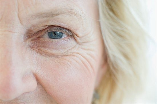 Wrinkled face of an older woman