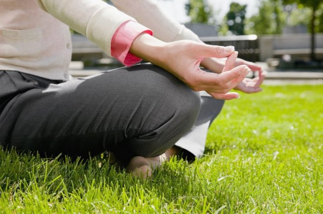 Woman meditating in the grass