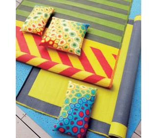 10 great items to add a punch of colour to your outdoor for Cb2 indoor outdoor rug