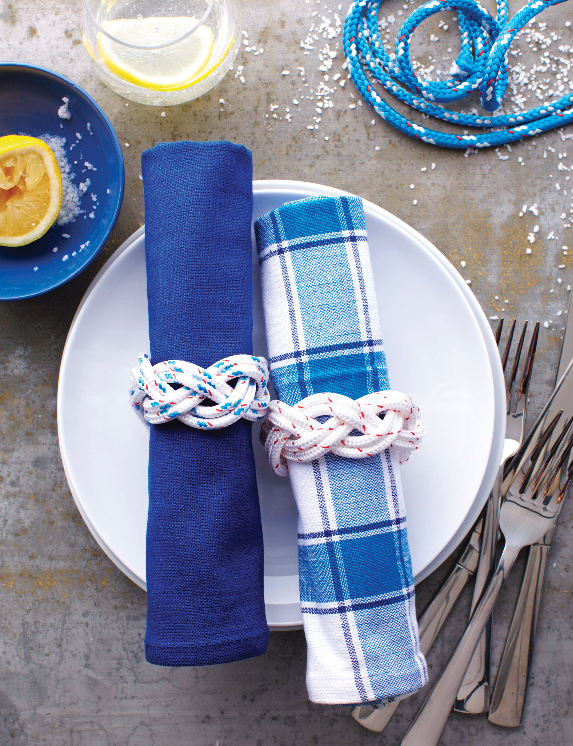 Place setting with blue and white napkins and plates
