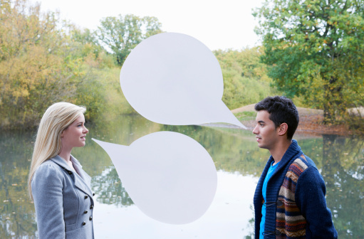 couple talking outdoors speech bubble, relationship and communication