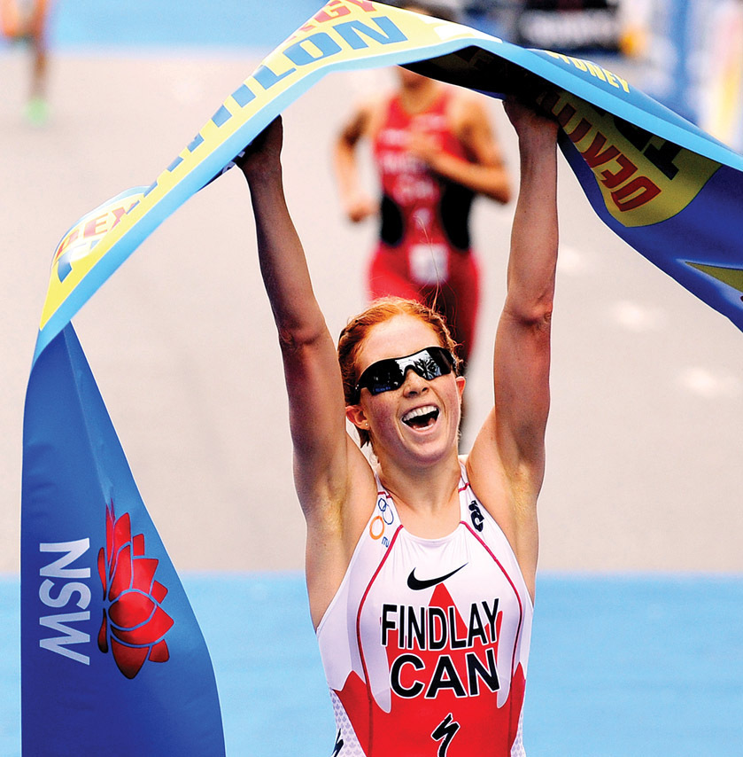 Paula Findlay crosses Triathlon race finish line