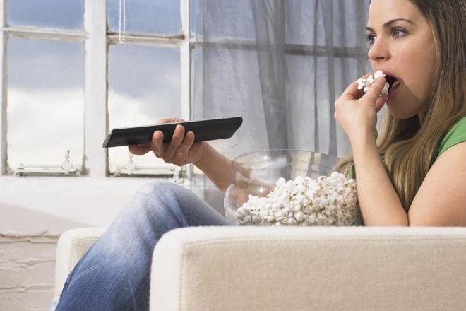Watching tv eating popcorn