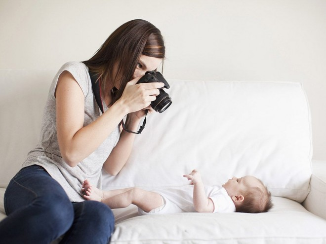 Mother taking photo of her baby