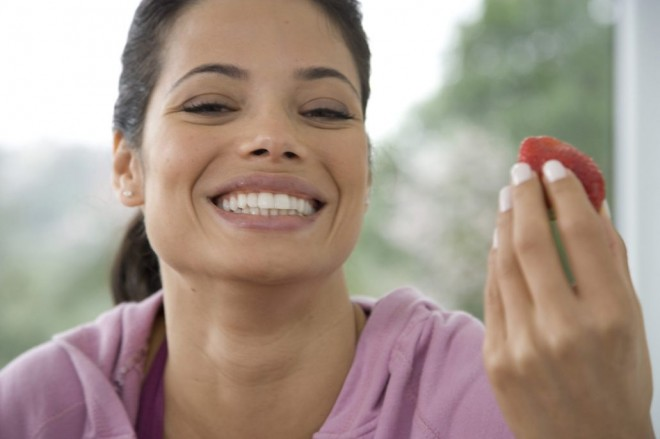 strawberry smiling woman