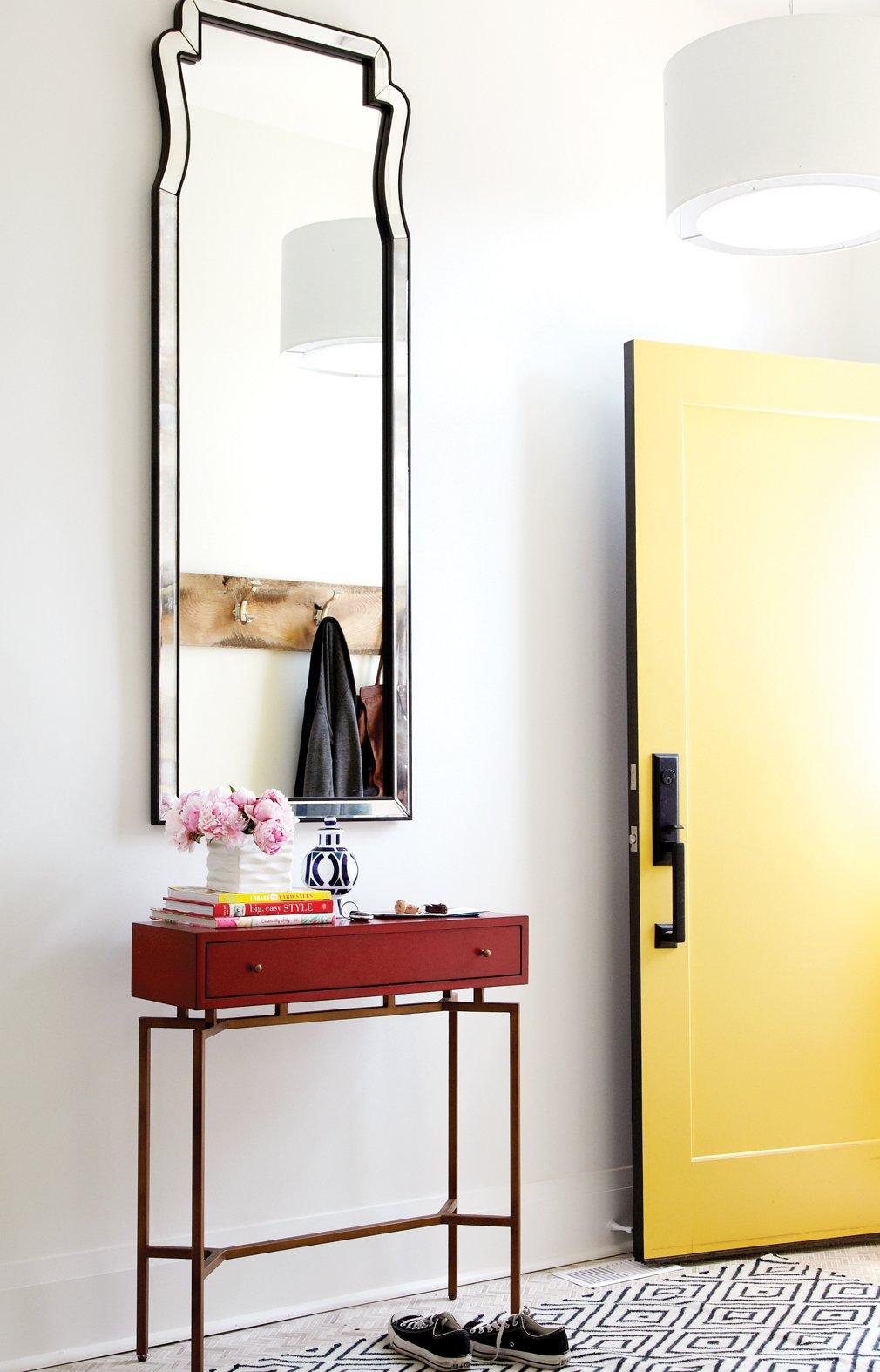 Hallway, tall mirror, small side table, yellow door