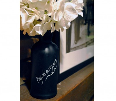 Chalkboard wine bottle vase with hydrangeas