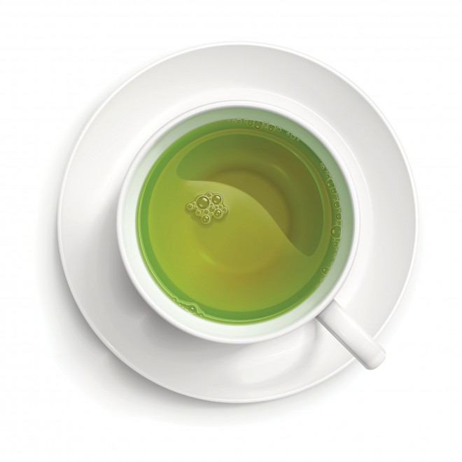 White cup with green tea