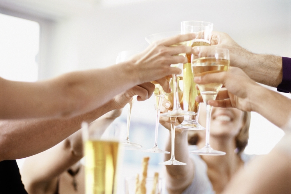 Cheers at a party with alcohol