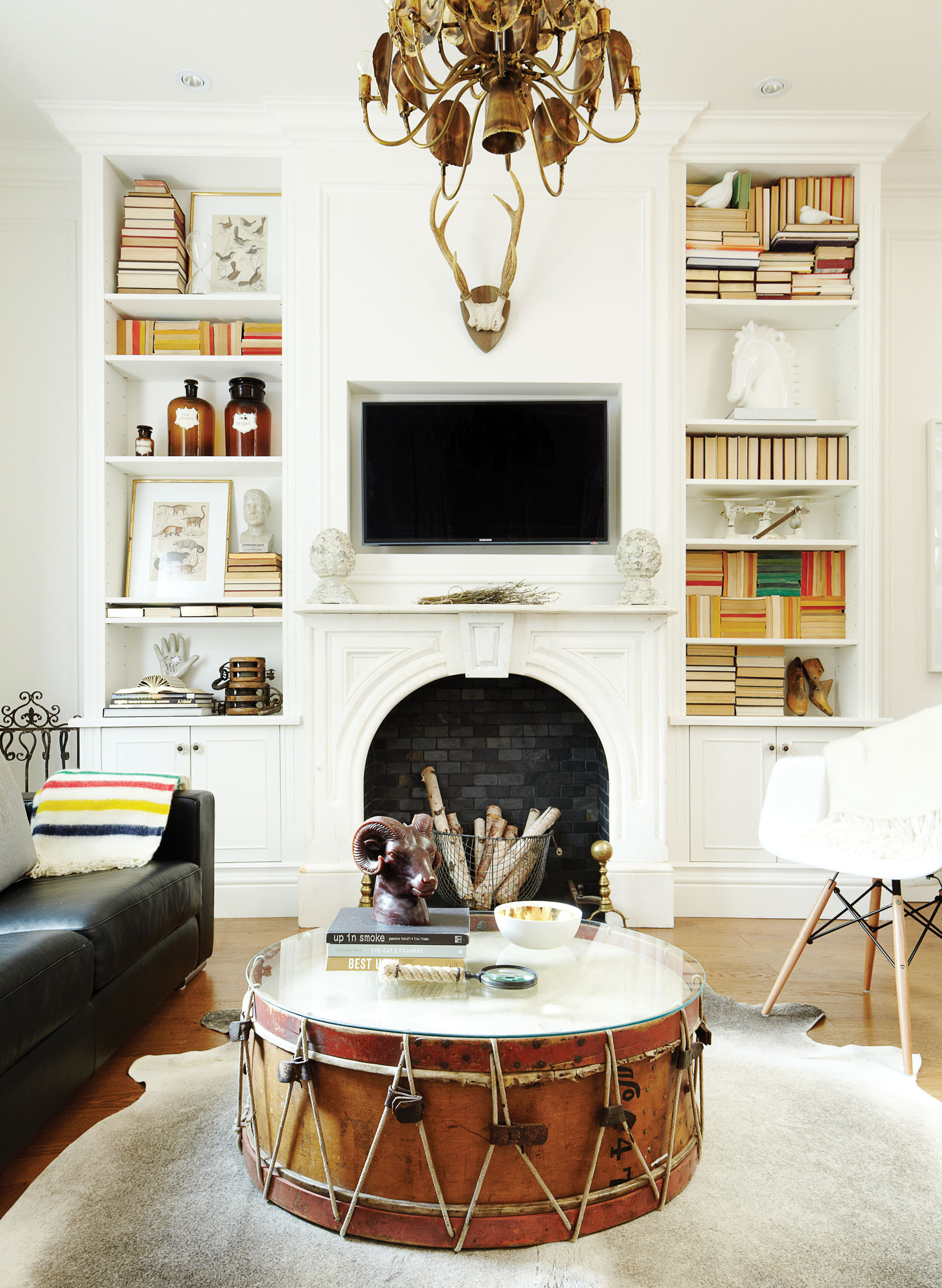 Living room, fireplace, drum coffee table, bookshelves