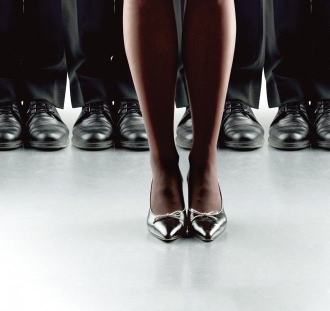 Woman in silver heels standing in front of men in black dress shoes