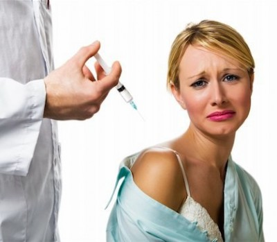 Flu shot, woman getting needle