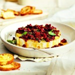 Baked brie with sun dried tomatoes and basil