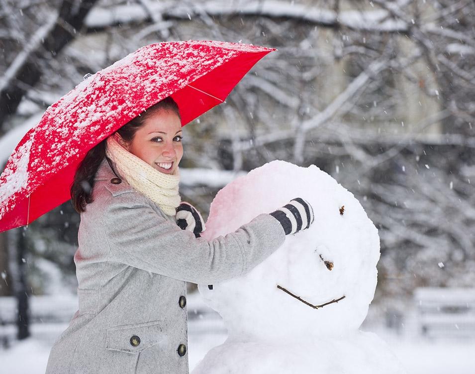 Woman Building a Snowman