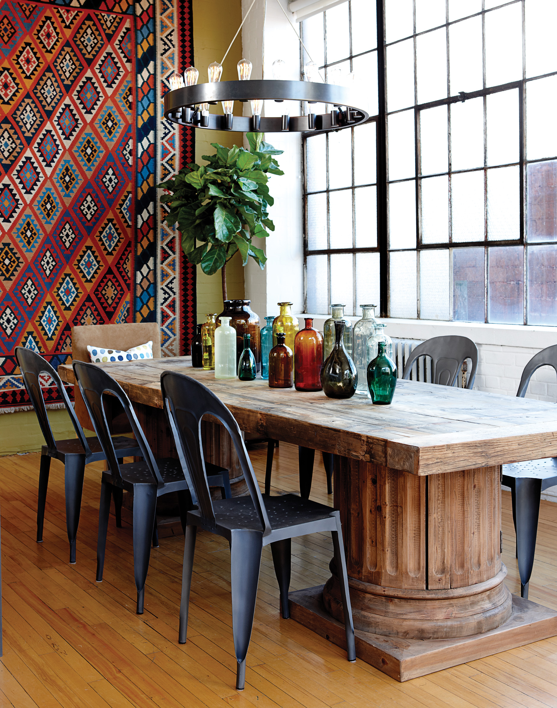 Dining room, glass bottles on table, patterned wall hanging, Jan 13, p62