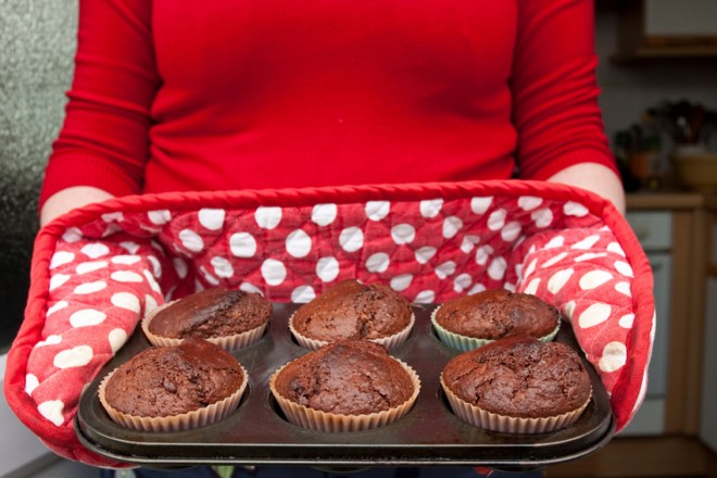 Woman giving muffins to guest