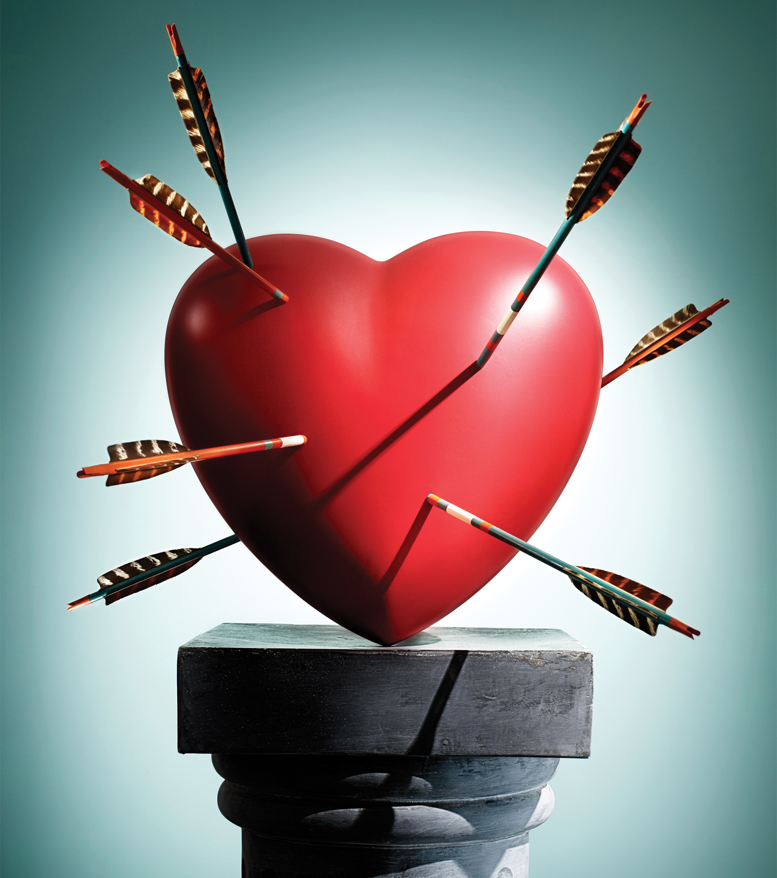 Red heart on pedestal stuck with arrows, Feb 13, p112