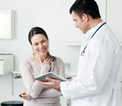 Relieved Woman With Doctor