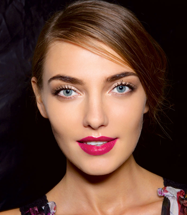 Model with brown hair and lip colour