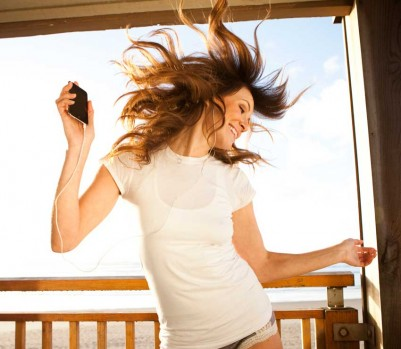 Woman Dancing on Porch listening to headphones