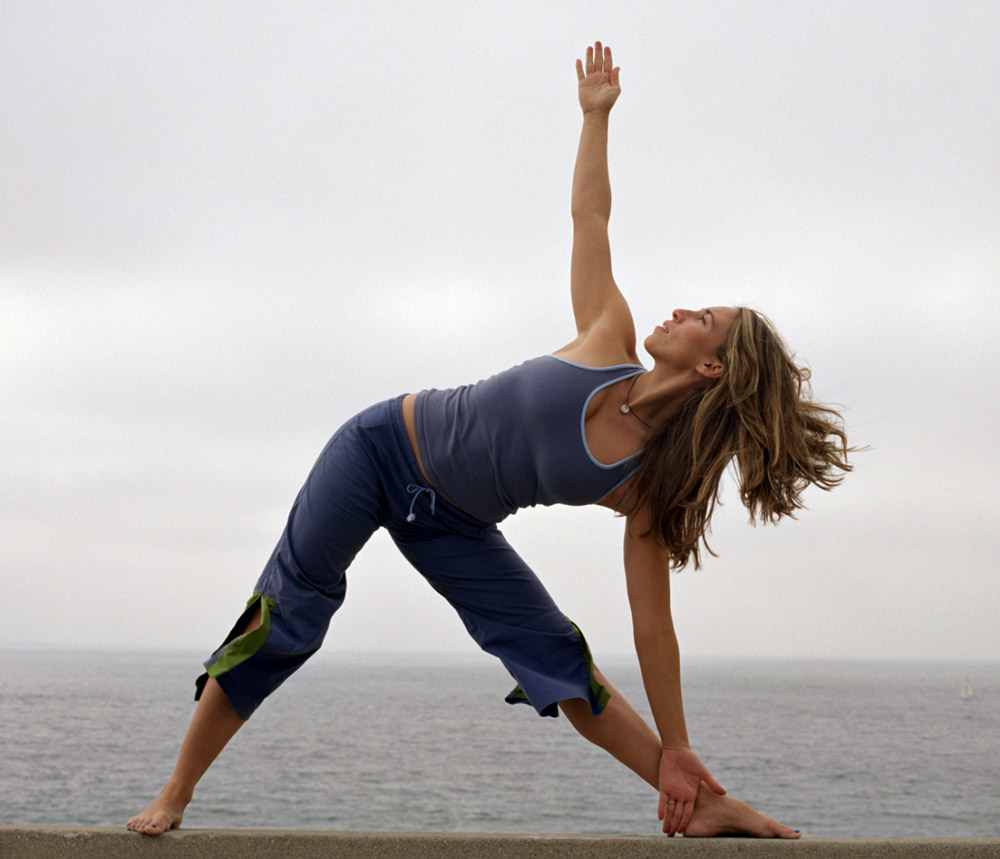 Triangle pose (shown here) can ease anxiety and is known to also improve digestion