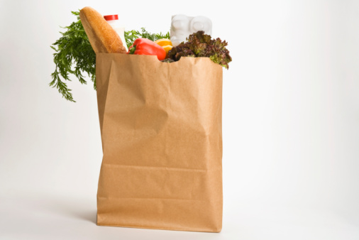 Large paper bag with groceries, food
