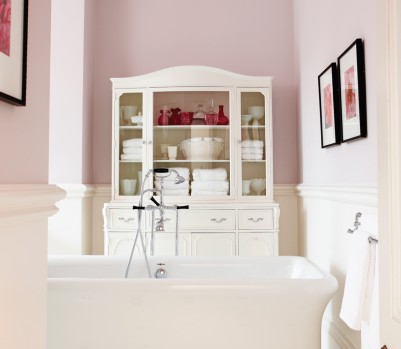 Pretty in pink bathroom white bathtub April 13 p87