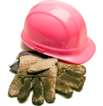 Pink construction hard hat with dirty gloves