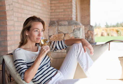 Woman enjoying wine on the terrace