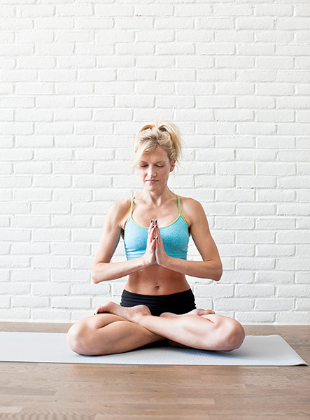 Andrea Mills poses at Barreworks on Queen West meditating and doing yoga