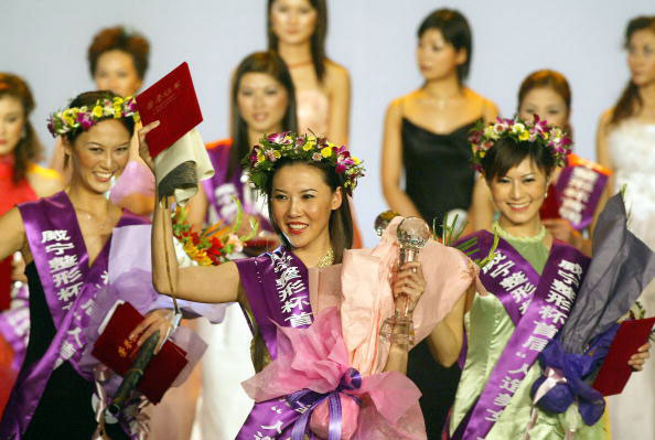 Plastic beauties celebrate at the conclusion of China's first Miss Plastic Surgery pageant in Beijing. (Photo FREDERIC J. BROWN/AFP/Getty Images)