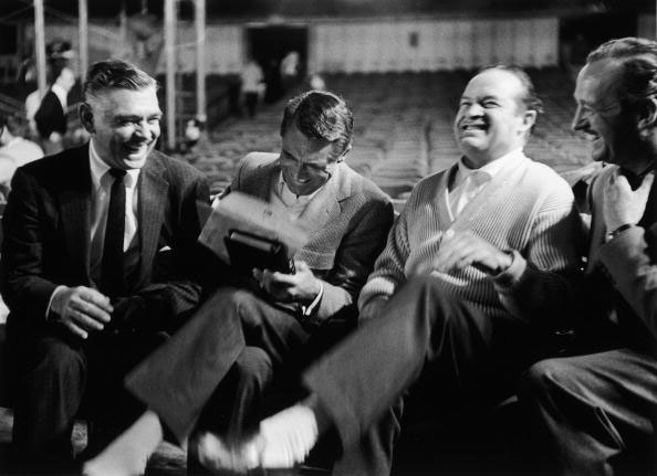 Actors (L-R) Clark Gable, Cary Grant, Bob Hope and David Niven laughing heartily together at one of Hope's jokes during break from rehearsals for 30th annual Academy Awards .