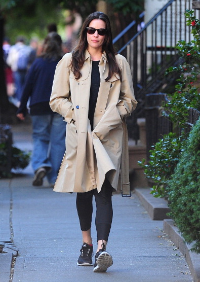 Liv Tyler in a trench and gym