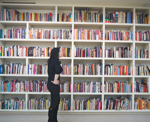 Nigella in front of a small part of her book collection