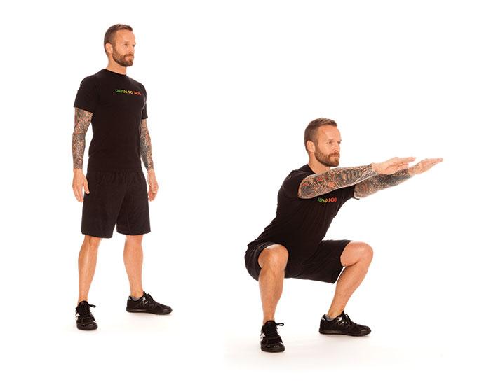 Bob Harper exercises air squats