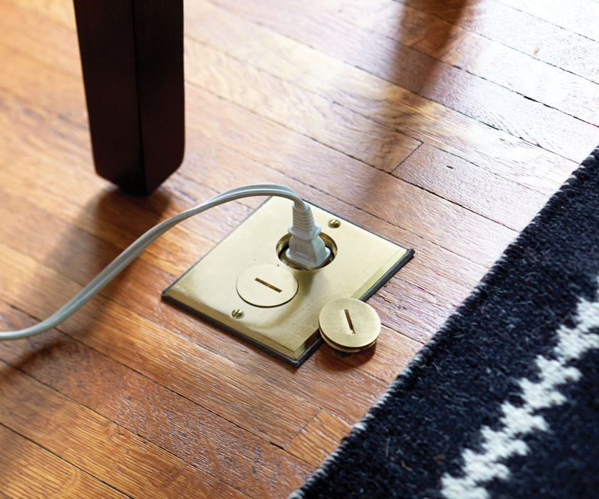 12 ingenious ways to keep your home clutter free chatelaine for Floor electrical outlet