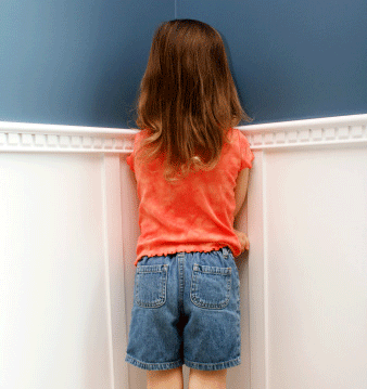 young-girl-standing-in-corner-time-out